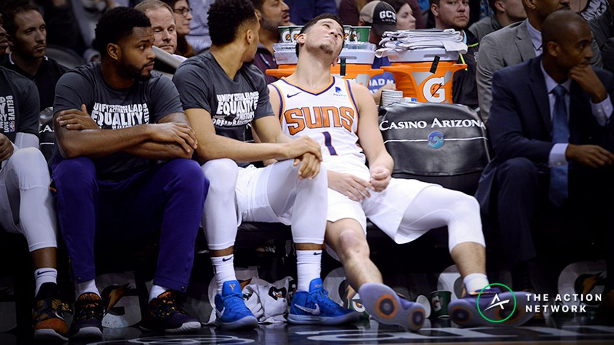 Wednesday's NBA Injury Report: Betting, DFS Impact of Devin Booker and Spurs Injuries article feature image
