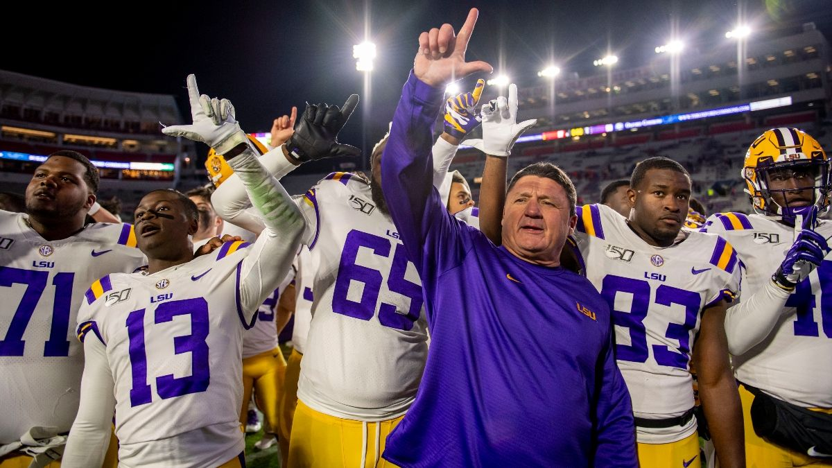 Behind the Scenes as Vegas Bookmakers Open College Football Playoff Odds: Clemson, LSU Take Early Action article feature image