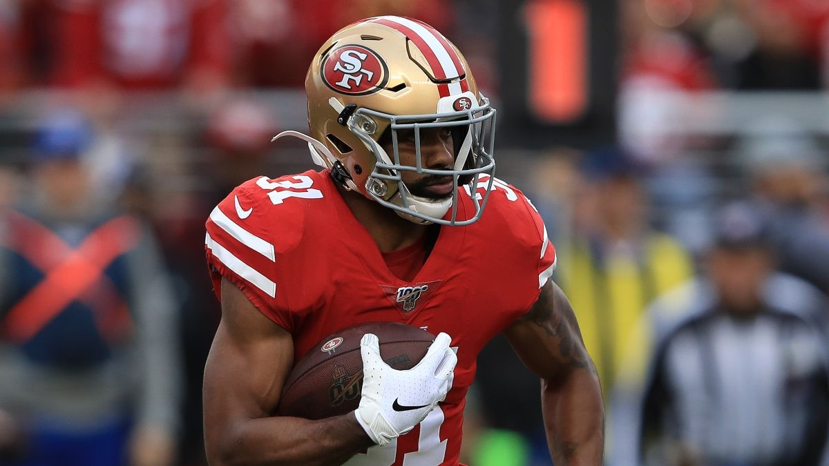 Raheem Mostert Injures Knee vs. Lions, Questionable To Return for Fantasy Football Managers article feature image