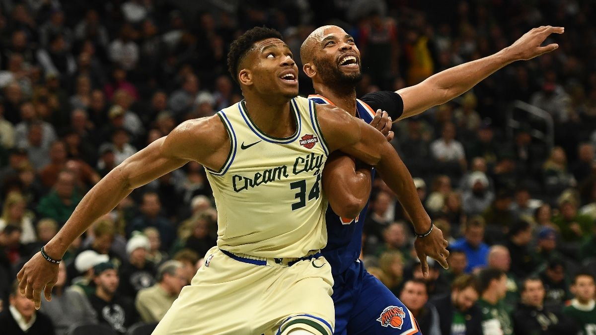 NBA Sharp Betting Picks (Jan. 14): Pros Moving Over/Unders in Knicks vs. Bucks, Rockets vs. Grizzlies article feature image