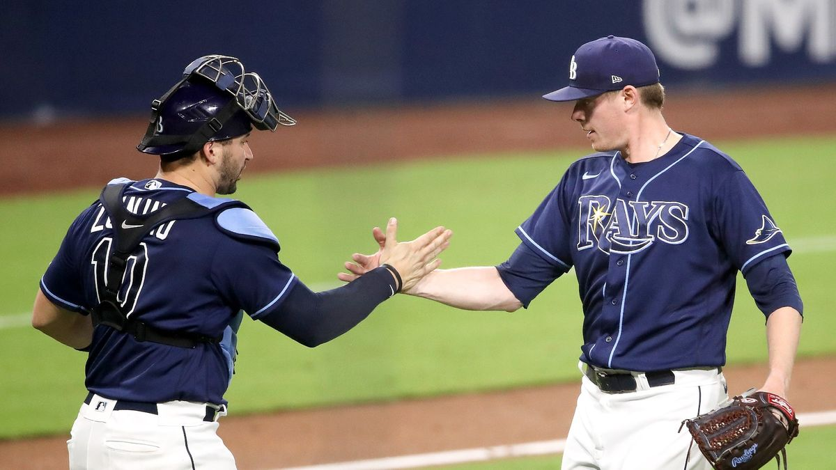 MLB Playoff Odds & Picks: How to Bet Yankees vs. Rays & Padres vs. Dodgers article feature image