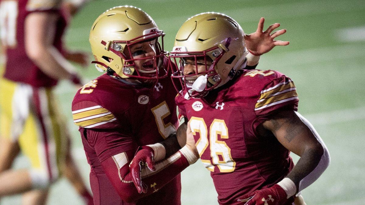 Saturday College Football Sharp Betting Picks for Week 14: Boston College vs. Virginia, Tulsa vs. Navy & More article feature image