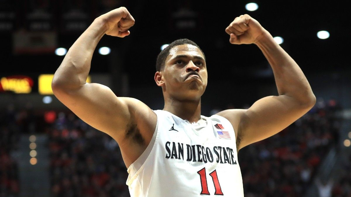 College Basketball Odds, Picks, Predictions: Our Best Bets for Friday Night's NCAA Tournament Games, Including North Carolina vs. Wisconsin & San Diego State vs. Syracuse (March 19) article feature image