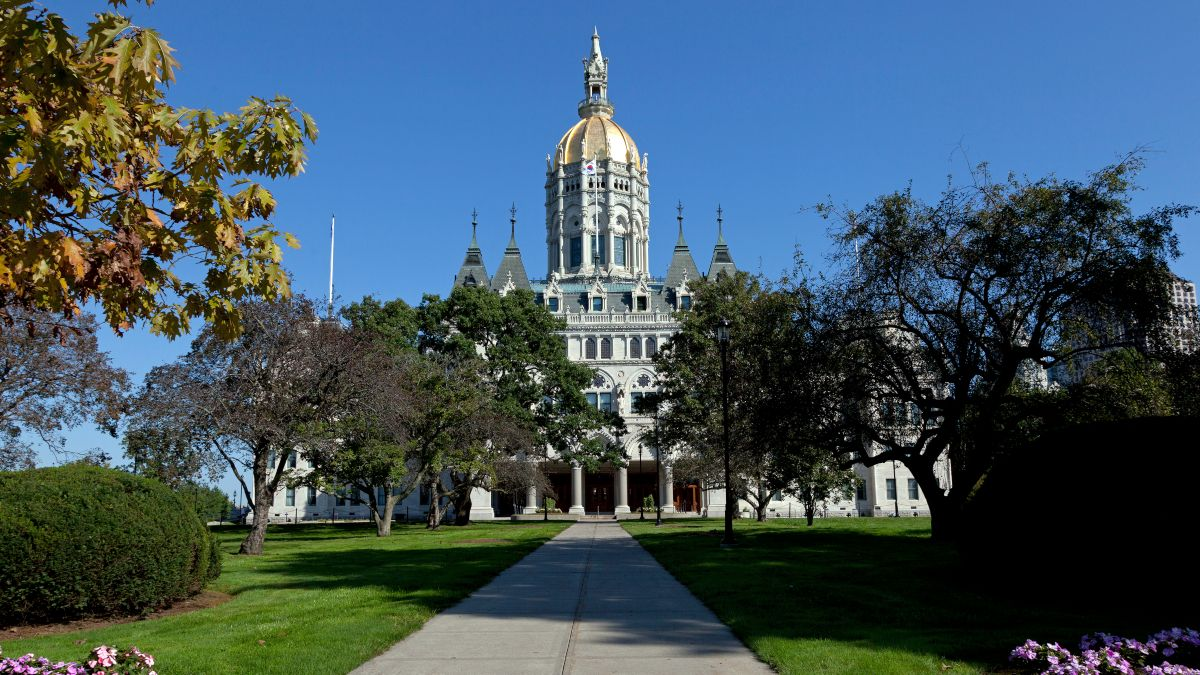 Connecticut Gov. Ned Lamont Signs State Gaming Compact to Legalize Sports Betting article feature image
