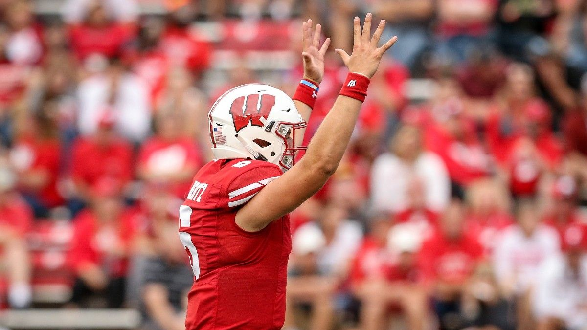 College Football Game of the Year Odds & Picks: 3 Bets for Wisconsin vs. Notre Dame, UCLA vs. Stanford & More article feature image