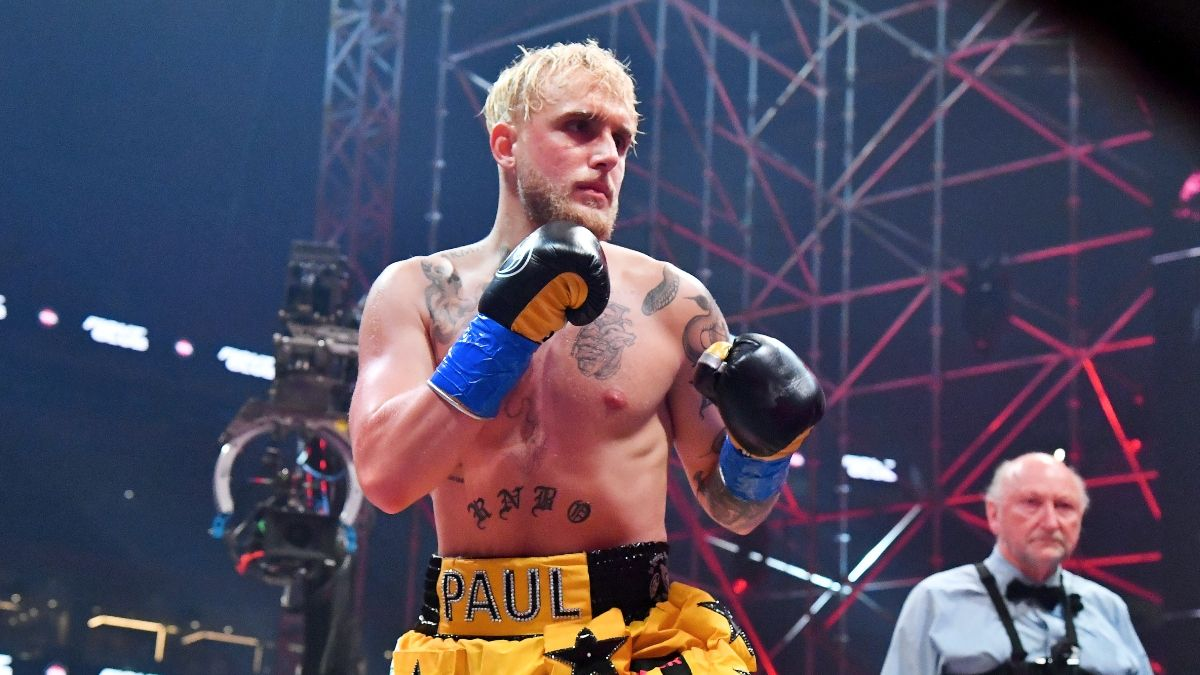 Who Is the Betting Favorite in Paul-Woodley? Odds, Start Time, More for Sunday Boxing Match article feature image