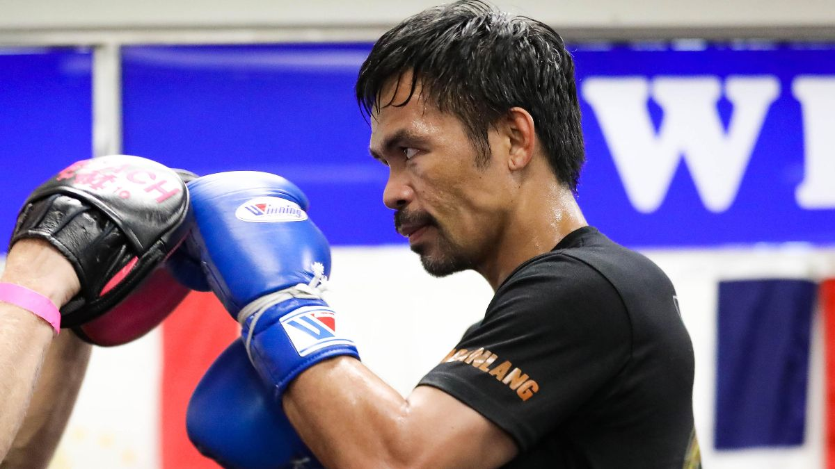 Manny Pacquiao vs. Yordenis Ugas Odds: Tracking Line Moves for Saturday's Title Fight article feature image