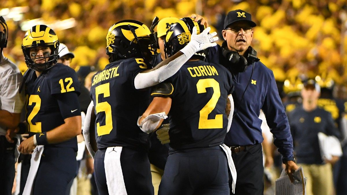 Michigan vs. Wisconsin College Football Odds & Picks: How To Bet Saturday's Big Ten Battle (Oct. 2) article feature image