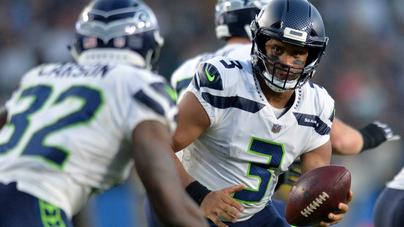 Seattle Seahawks quarterback Russell Wilson (3) looks to hand the ball off to running back Chris Carson (32) during the first quarter against the Los Angeles Chargers