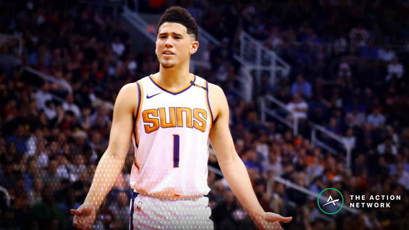 NBA Injury Report: Betting, DFS Impact of Devin Booker, Luka Doncic Injuries article feature image