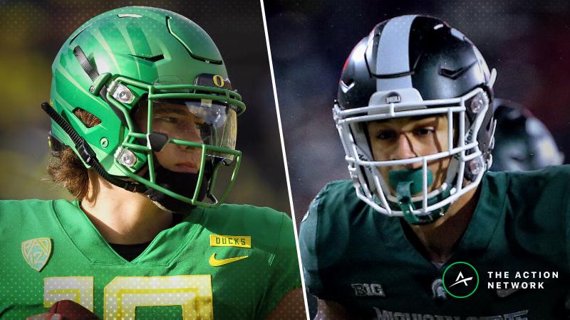 Oregon-Michigan State Betting Guide: Elite Defense vs. Elite QB in Redbox Bowl article feature image