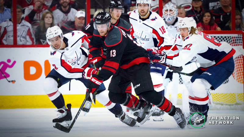 NHL Sharp Report: Pros Hitting Caps-Canes Game 6 Moneyline, Over/Under article feature image