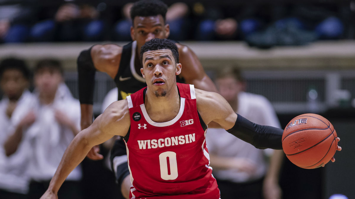 Monday College Basketball Betting Odds & Picks: Oklahoma State vs. Kansas, Iowa vs. Wisconsin article feature image
