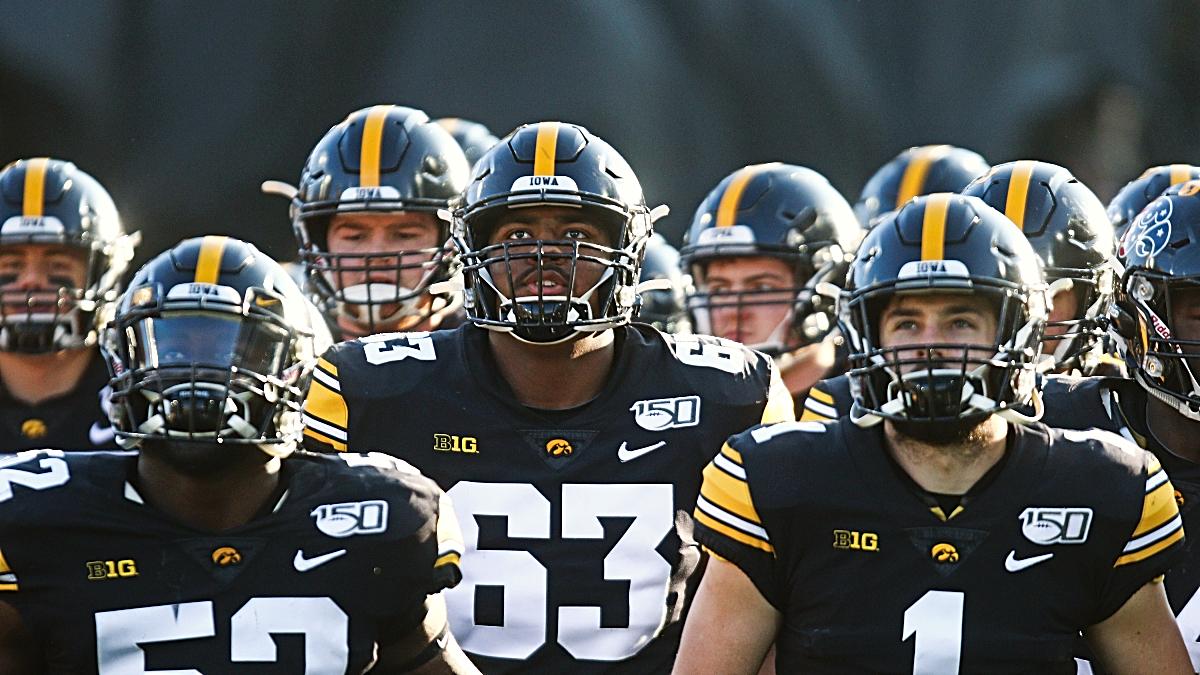 College Football Odds & Picks: How to Bet Iowa vs. Minnesota, Cincinnati vs. East Carolina, More Friday Games article feature image