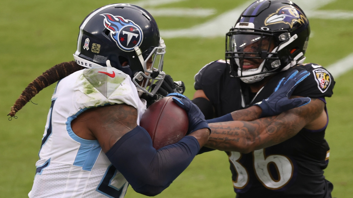 NFL Odds & Picks for Ravens vs. Titans: Money Moving Sunday's Wild Card Playoff Over/Under article feature image